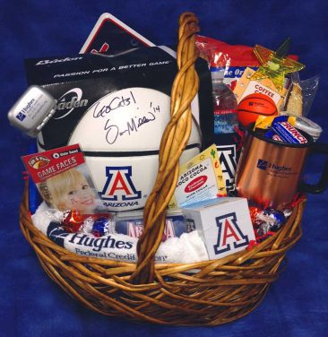 Hughes Federal Credit Union has partnered with Basket Butler to create gift baskets not only with their marketing products but also with University of Arizona products.