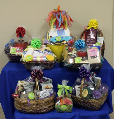 I built these baskets for a fundraiser for Temple Emanuel. They brought me most all of the items thinking they would get 3-4 gift baskets. I created 8 gift baskets for them.