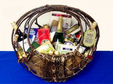 "This unique handcrafted basket measures 21""Tx23''Lx15""Wx8""D and as you can see I can fill this gift basket with just about everything including alcohol if you provide it."