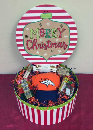 Sometimes I create gift baskets that are out of the norm for my clients. His wife is a Denver Bronco's fan and the fun thing with this gift basket is what you do not see.